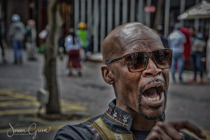 Local is singing in the streets of Capetown