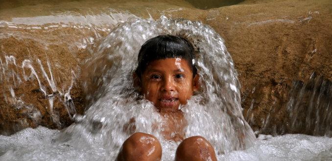 Kid in Waterfall