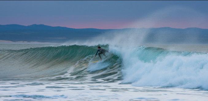 Surfer bij Jeffrey's Bay