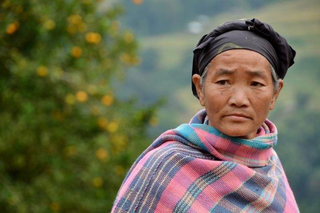 Vrouw in Adi Padan dorp