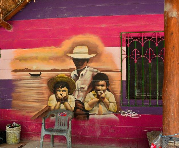 Familieportret op de muur