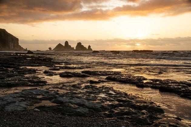 Zonsondergang aan de Westcoast, Nieuw-Zeeland