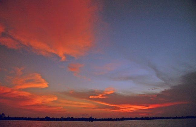 Zonsondergang over de Mekong