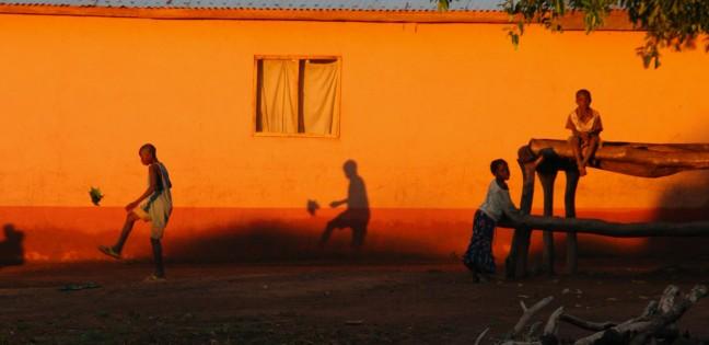 Playing football at sun set