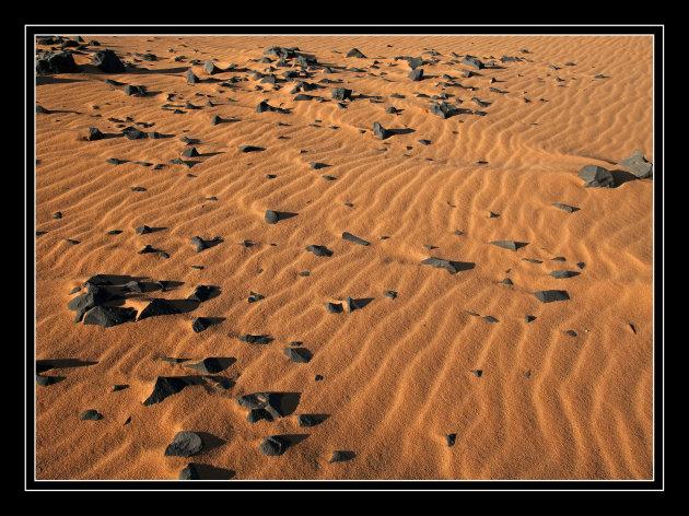 """golvend"" zand."