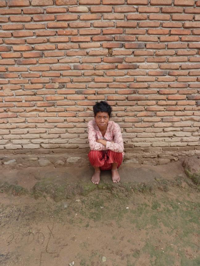 Arme vrouw in Kampong