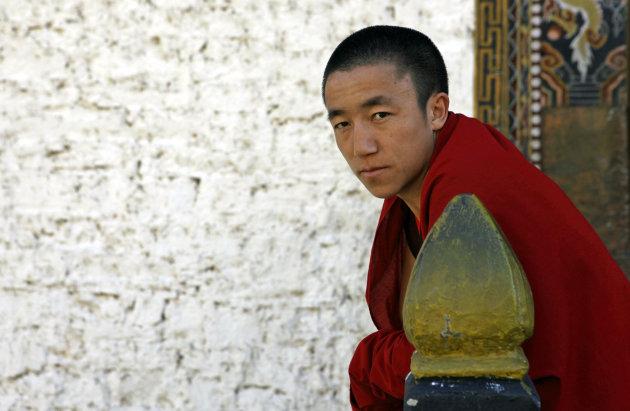 Monnik bij de /dzong van Thimpu