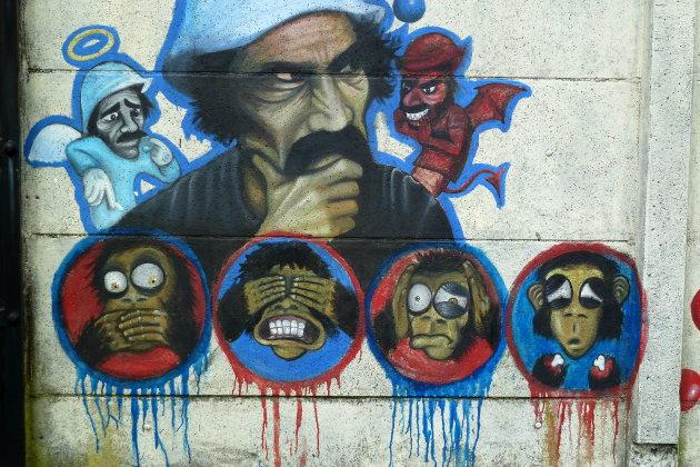 muurschildering Horen zien en zwijgen