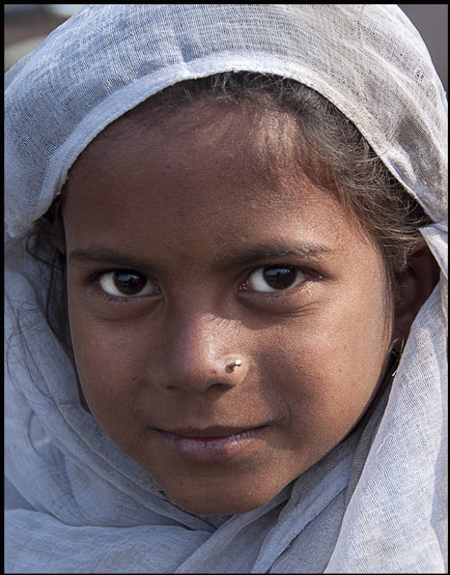 The little girl in white