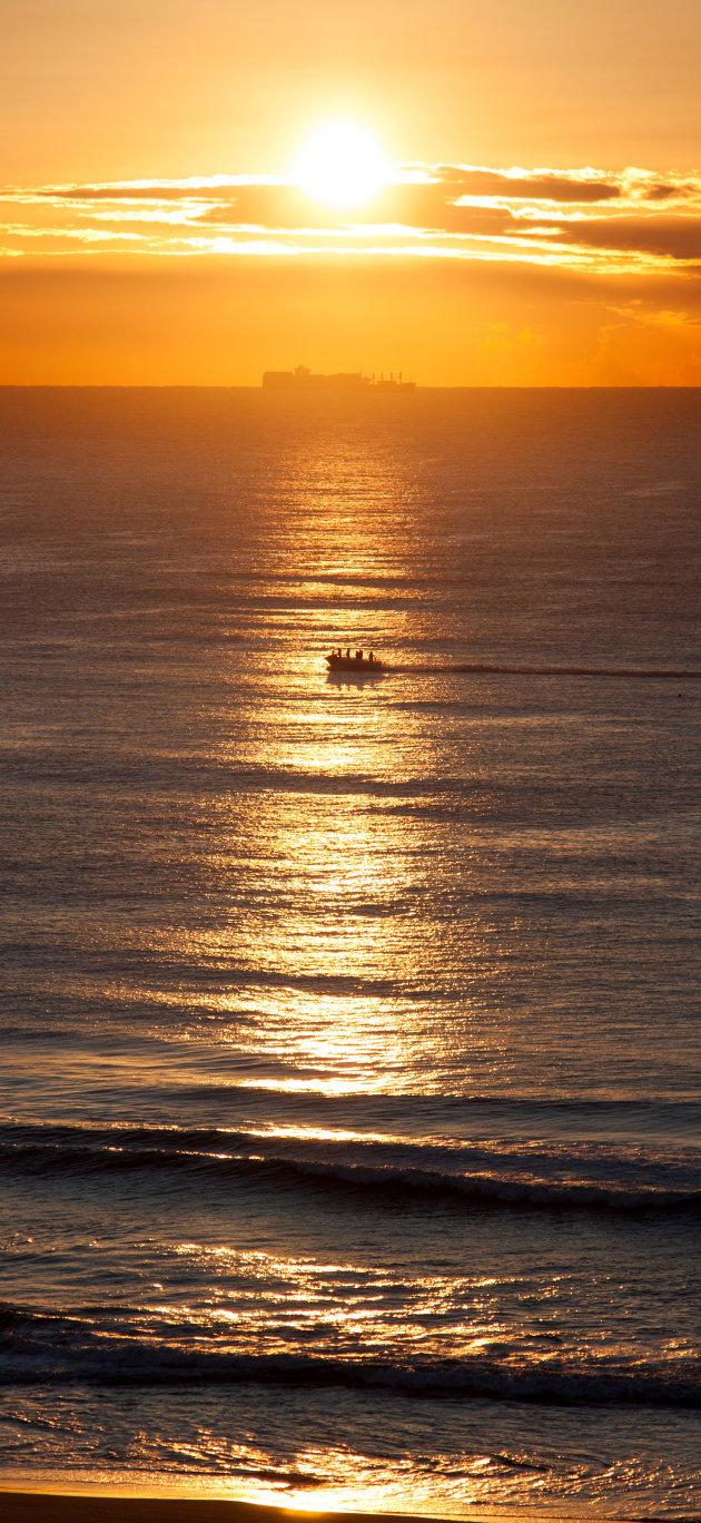 Schepen op zee bij Durban, zonsopkomst