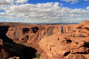 Man with blue shirt at the Horse Shoe Bend Overlook