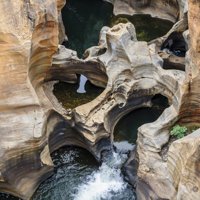 Voorvertoning Een foto bij bourke's luck potholes. Prachtig om te zien hoe het water structuren heeft geslepen in de rotsformaties.