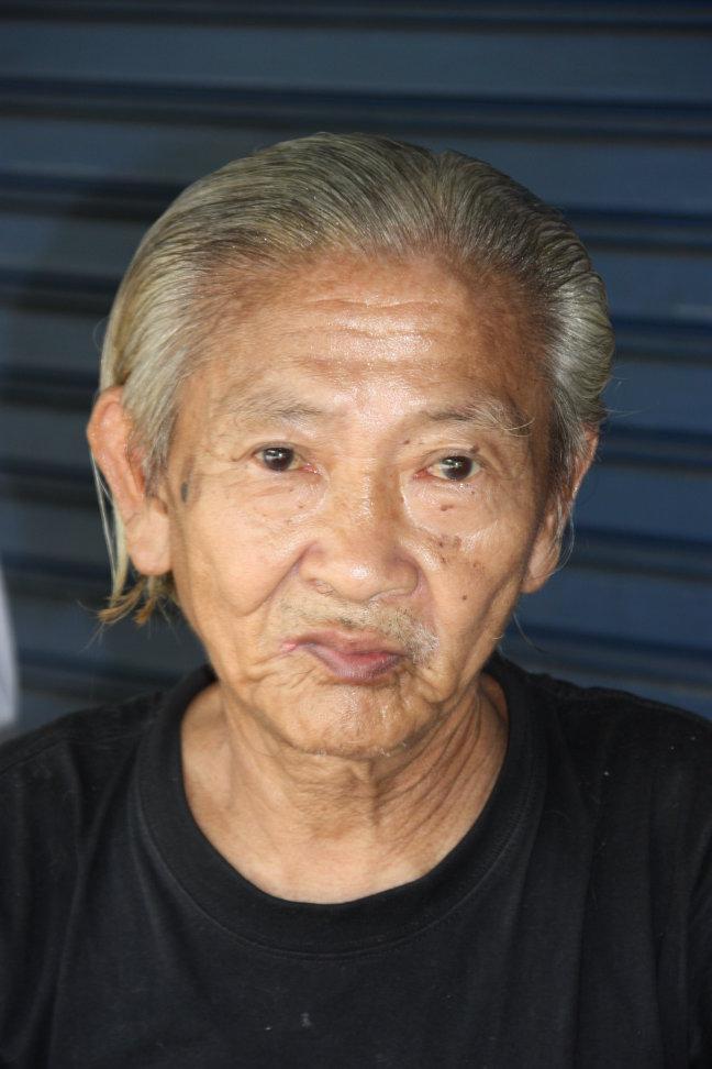 2008: Bangkok: man op straat.