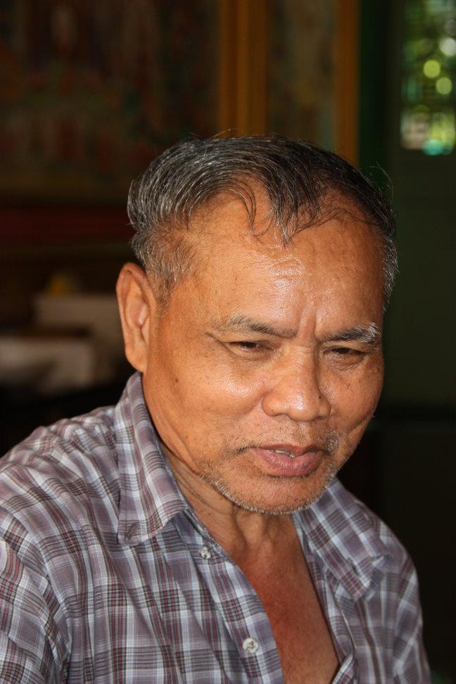2008: Bangkok: man bewaakt tempel