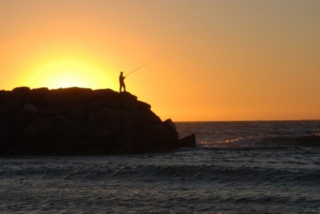 De visser en de ondergaande zon