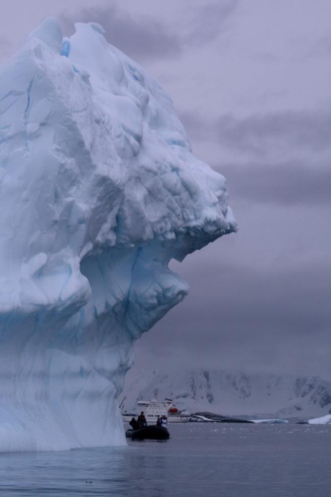 Iceberg and boat